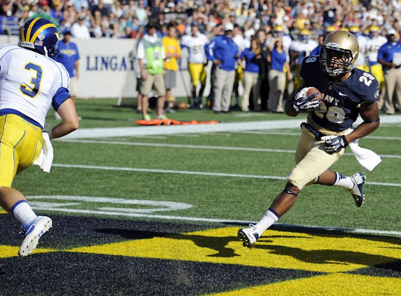 Reynolds leads Navy to 51-7 win over Delaware