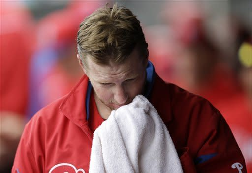 Halladay out after 1 inning because he's ill