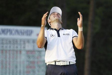 Martin Kaymer of Germany celebrates on the 18th green after winning the U.S. Open Championship golf tournament in Pinehurst