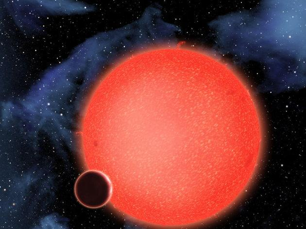 GJ1214b, shown in this artist's view, is a super-Earth orbiting a red dwarf star 40 light-years from Earth. New observations from the NASA/ESA Hubble Space Telescope show that it is a waterworld enshrouded by a thick, steamy atmosphere. GJ 1214b represents a new type of planet, like nothing seen in the Solar System or any other planetary system currently known. CREDIT: NASA, ESA, and D. Aguilar (Harvard-Smithsonian Center for Astrophysics)