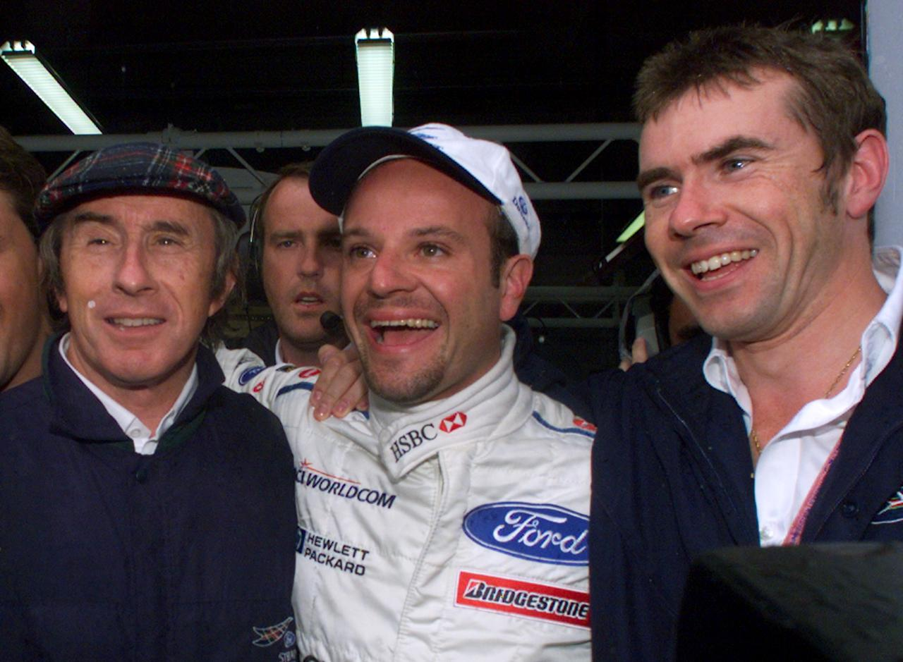 Brazilian Stewart-Ford driver Rubens Barrichello (C) jubilates with his team director Jackie Stewart (L) and his son Paul (R) after winning the pole-position at the end of the qualifying session, 26 June 1999 on Magny-Cours racetrack, on the eve of the 85th French Formula One Grand Prix. (ELECTRONIC IMAGE)Brazilian Stewart-Ford driver Rubens Barrichello (C) jubilates with his team director Jackie Stewart (L) and his son Paul (R) after winning the pole-position at the end of the qualifying session, 26 June 1999 on Magny-Cours racetrack, on the eve of the 85th French Formula One Grand Prix. (ELECTRONIC IMAGE) (AFP Photo/PIERRE VERDY)