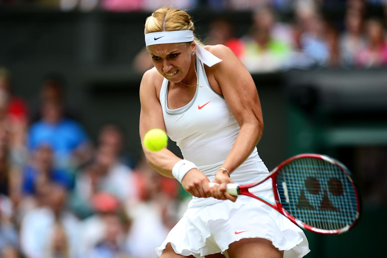 LONDON, ENGLAND - JULY 01: Sabine Lisicki of Germany plays a backhand during her Ladies' Singles fourth round match against Serena Williams of United States of America on day seven of the Wimbledon Lawn Tennis Championships at the All England Lawn Tennis and Croquet Club on July 1, 2013 in London, England. (Photo by Mike Hewitt/Getty Images)