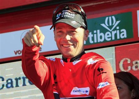 Horner of the U.S. celebrates on the podium after retaking the overall lead in 19th stage of the Vuelta, Tour of Spain, cycling race from San Vicente de la Barquera to Alto del Naranco
