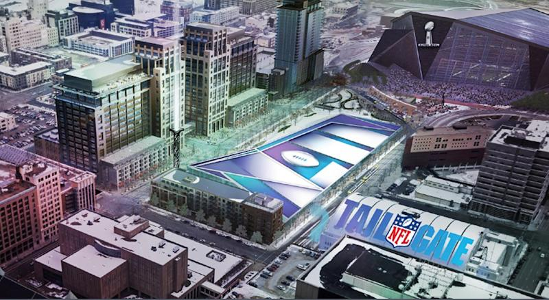 In this artist's rendering provided by the Minnesota Vikings on Wednesday, May 21, 2014, a Super Bowl LII logo covers a seven-acre prime space for an NFL tailgate party next to the new stadium, top right, which is under construction in Minneapolis. The image was part of the presentation made to NFL team owners before they voted to hold the 2018 Super Bowl in Minneapolis