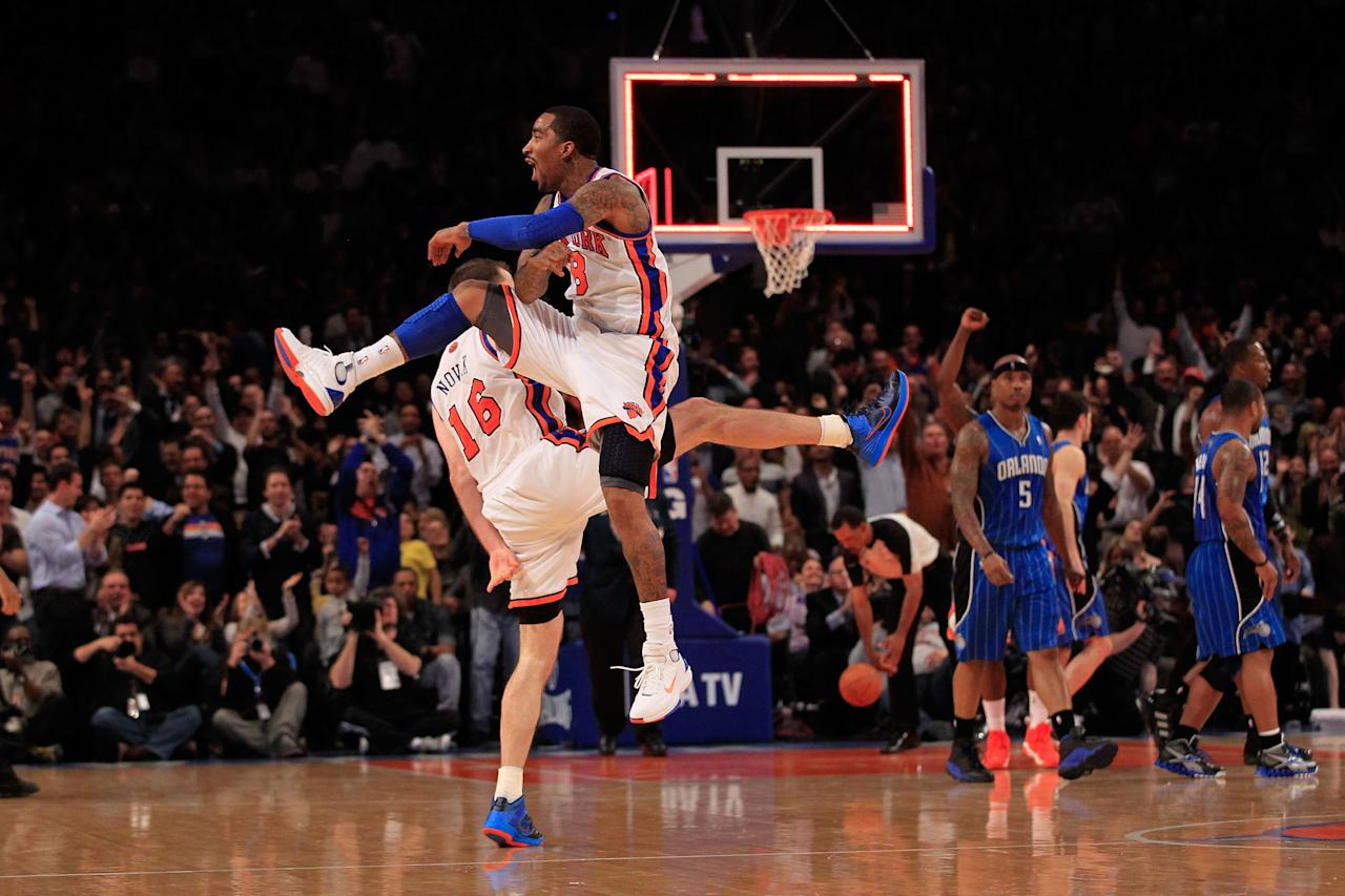 NEW YORK, NY - MARCH 28:  (L) Steve Novak #16 of the New York Knicks and (R) J.R. Smith #8 of the New York Knicks chest bump after Novak hits a three pointer at the end of the first quarter against the Orlando Magic at Madison Square Garden on March 28, 2012 in New York City. NOTE TO USER: User expressly acknowledges and agrees that, by downloading and/or using this Photograph, user is consenting to the terms and conditions of the Getty Images License Agreement.  (Photo by Chris Trotman/Getty Images)