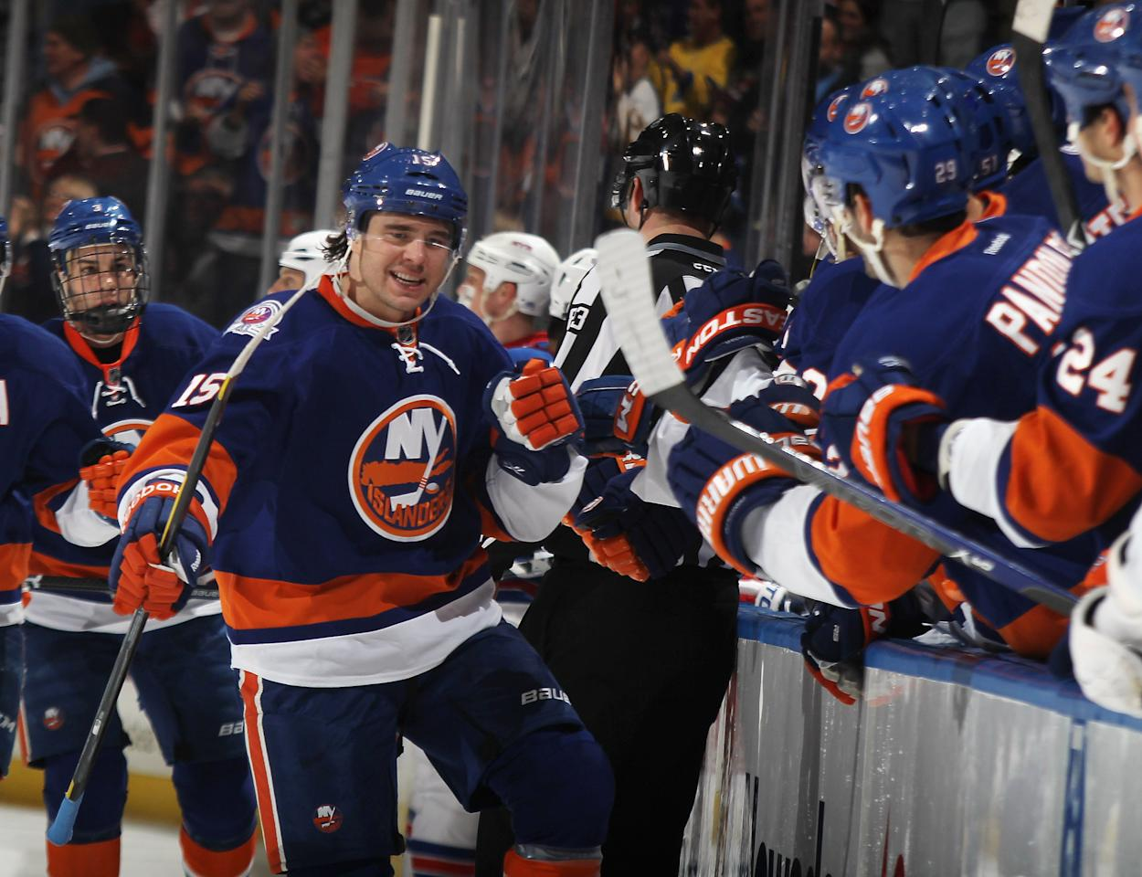 UNIONDALE, NY - FEBRUARY 24: P.A. Parenteau #15 of the New York Islanders celebrates his first period goal against the New York Rangers at the Nassau Veterans Memorial Coliseum on February 24, 2012 in Uniondale, New York. The Islanders defeated the Rangers 4-3 in the shootout. (Photo by Bruce Bennett/Getty Images)