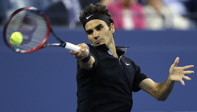 Roger Federer had a unique evening to advance to the semifinals. (AP)