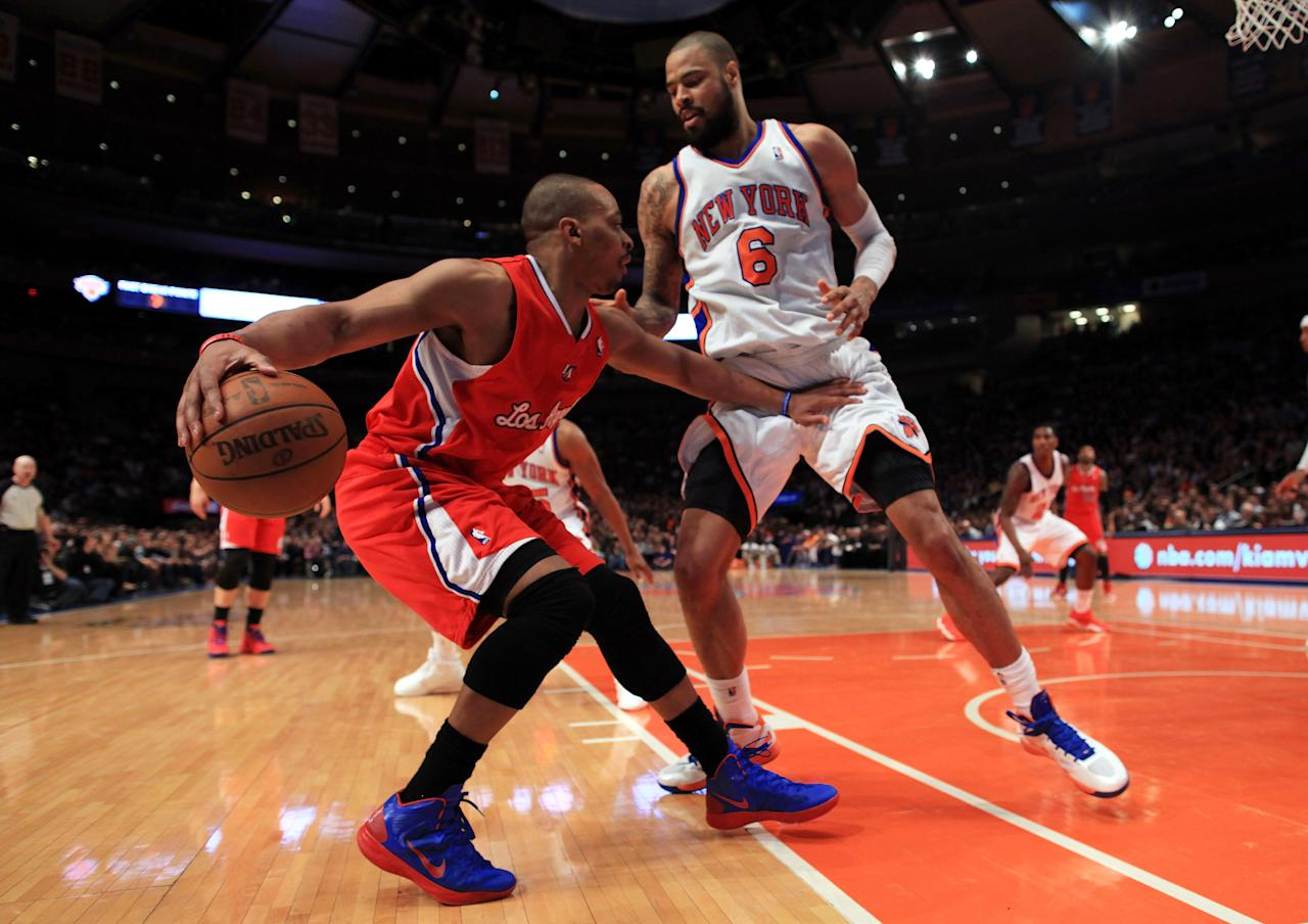 NEW YORK, NY - APRIL 25: Randy Foye #4 of the Los Angeles Clippers handles the ball against Tyson Chandler #6 of the New York Knicks at Madison Square Garden on April 25, 2012 in New York City. NOTE TO USER: User expressly acknowledges and agrees that, by downloading and/or using this Photograph, user is consenting to the terms and conditions of the Getty Images License Agreement.  (Photo by Chris Trotman/Getty Images)
