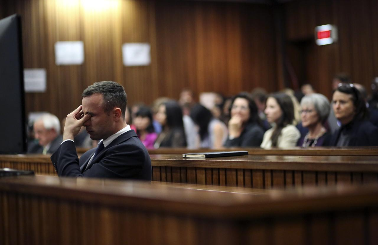 Olympic and Paralympic track star Oscar Pistorius reacts during his trial at North Gauteng High Court in Pretoria April 15, 2014. The prosecutor in the murder trial of Pistorius ended his five-day cross-examination of the double amputee track star on Tuesday with a stark summary of how he shot his girlfriend Reeva Steenkamp, insisting he killed her deliberately after an argument. REUTERS/Siphiwe Sibeko (SOUTH AFRICA - Tags: SPORT ATHLETICS CRIME LAW TPX IMAGES OF THE DAY)