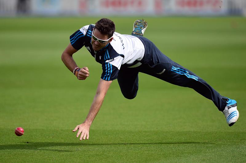 England's James Anderson dives for the ball during a practice session at the Oval cricket ground in London on August 14, 2014