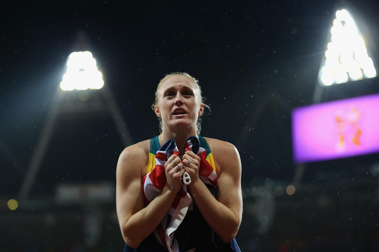 LONDON, ENGLAND - AUGUST 07:  Sally Pearson of Australia celebrates after winning the gold medal in the Women's 100m Hurdles Final on Day 11 of the London 2012 Olympic Games at Olympic Stadium on August 7, 2012 in London, England.  (Photo by Streeter Lecka/Getty Images)