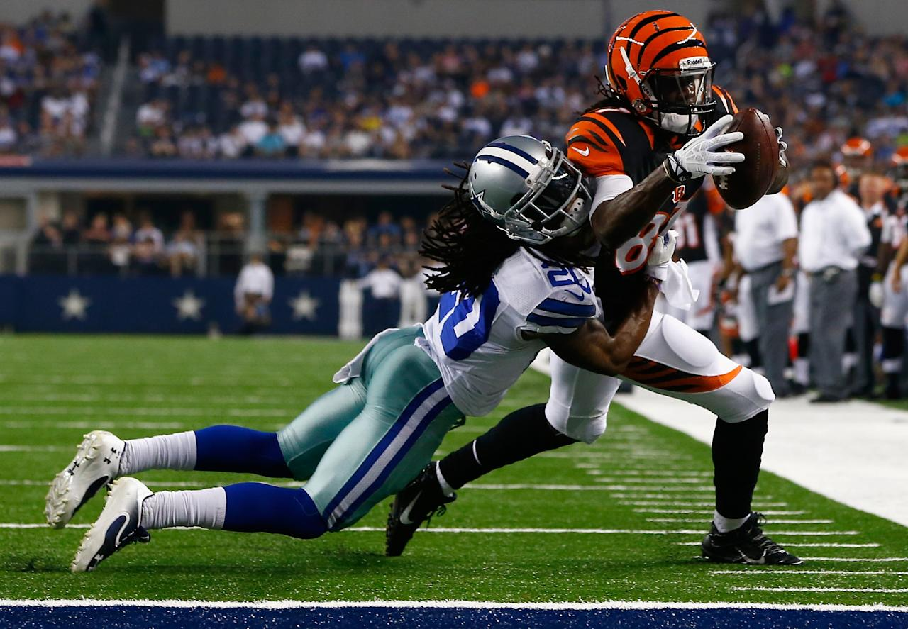 ARLINGTON, TX - AUGUST 24: Cobi Hamilton #87 of the Cincinnati Bengals dives into the end zone to score a touchdown against B.W. Webb #20 of the Dallas Cowboys in the fourth quarter during a preseason game at AT&T Stadium on August 24, 2013 in Arlington, Texas. (Photo by Tom Pennington/Getty Images)
