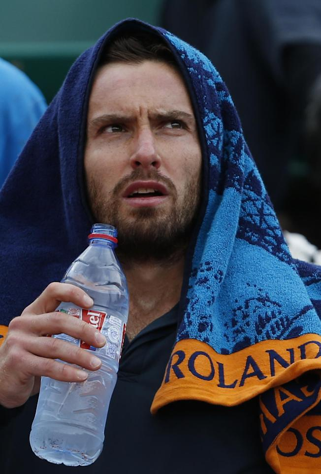 Latvia's Ernests Gulbis drinks during the quarterfinal match of the French Open tennis tournament against Tomas Berdych of the Czech Republic at the Roland Garros stadium, in Paris, France, Tuesday, June 3, 2014. Gulbis won in three sets 6-3, 6-2, 6-4. (AP Photo/Darko Vojinovic)