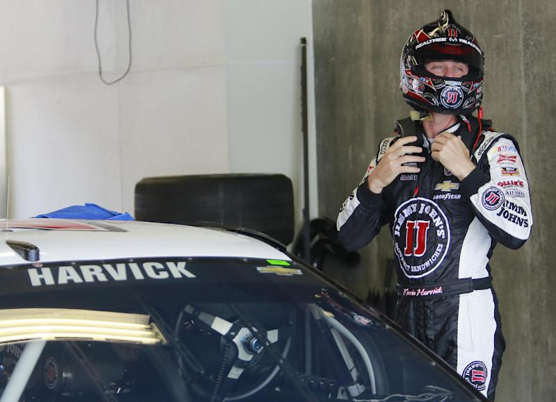 Driver Kevin Harvick prepares to practice for the Brickyard 400 Sprint Cup series auto race at the Indianapolis Motor Speedway in Indianapolis, Saturday, July 26, 2014