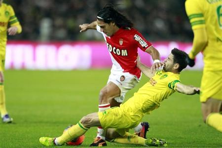 FC Nantes' Olivier Veigneau challenges AS Monaco's Radamel Falcao during their French Ligue 1 soccer match at the Beaujoire in Nantes