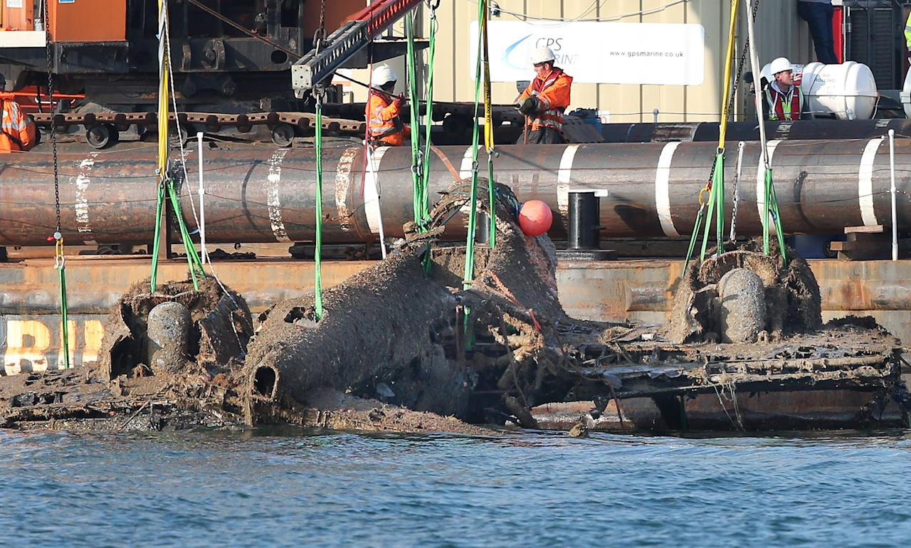 RAMSGATE, ENGLAND - JUNE 10:  A World War II Dornier 17 aircraft is lifted from waters of the English Channel on June 10, 2013 near Ramsgate, England. The salvage was planned through the RAF Museum to lift the only remaining German bomber Dornier 17, used during the 'Battle of Britain' of 1940. The plane on the Goodwin Sands is believed to be aircraft call-sign 5K-AR, shot down on August 26, 1940 at the height of the battle by RAF Boulton-Paul Defiant fighters. The Project has suffered many delays due to poor weather. Once recovered, the aircraft will be preserved and put on displayed for the public at the museum's Hendon base in north London  (Photo by Peter Macdiarmid/Getty Images)