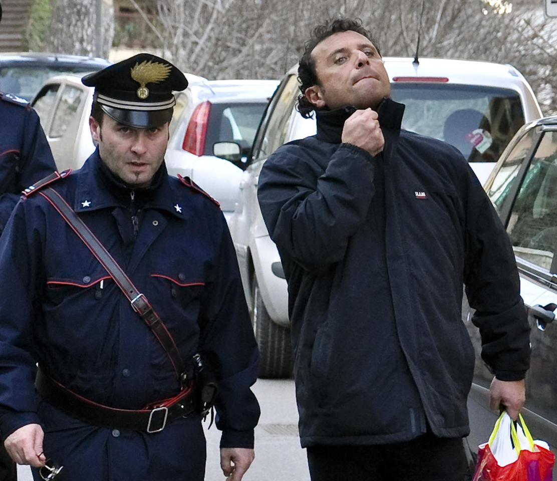 FILE In this In this Saturday, Jan. 14, 2012 file photo Francesco Schettino, right, the captain of the luxury cruiser Costa Concordia, which ran aground off Italy's tiny Tuscan island of Isola del Giglio, is taken into custody by Carabinieri in Porto Santo Stefano, Italy. Seamen have expressed almost universal outrage at Capt. Francesco Schettino, accused of manslaughter, causing a shipwreck and of abandoning his crippled cruise ship off Tuscany while passengers were still on board. The charge of abandoning his ship carries a potential sentence of 12 years in prison. Seafaring tradition holds that the captain should be last to leave a sinking ship. But is it realistic to expect skippers _ only human after all _ to suppress their survival instinct amid the horror of a maritime disaster? To ask them to stare down death from the bridge, as the lights go out and the water rises, until everyone else has made it to safety? From mariners on ships plying the world's oceans, the answer is loud and clear: Aye. (AP Photo/Giacomo Aprili, File)