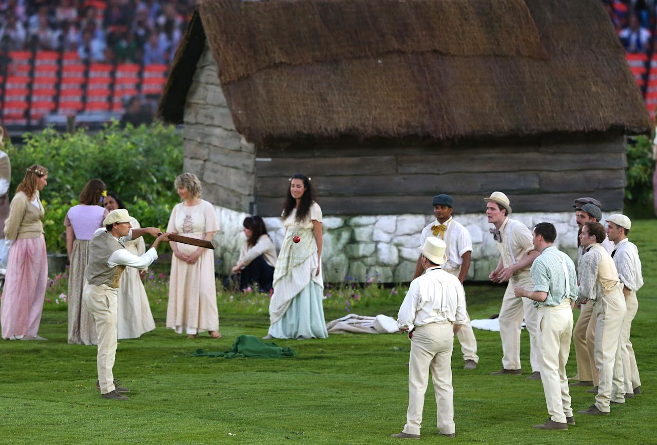 LONDON, ENGLAND - JULY 27:  Cricketers play cricket on the pitch during the preshow prior to the Opening Ceremony of the London 2012 Olympic Games at the Olympic Stadium on July 27, 2012 in London, England.  (Photo by Alex Livesey/Getty Images)
