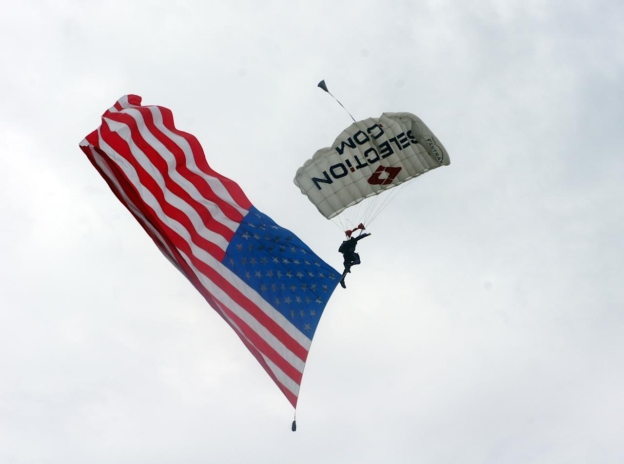 A professional skydiver swoops to the ground at the Constitution Center during a Flag Day celebration, Friday, June 14, 2013, in Philadelphia. (AP Photo/Keith Collins)