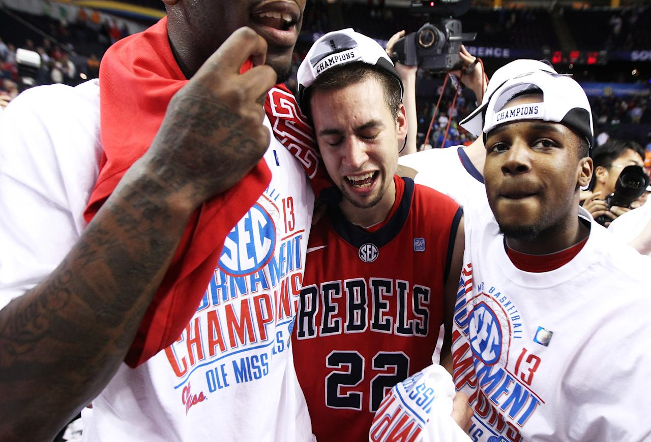 NASHVILLE, TN - MARCH 17:  Marshall Henderson #22 of the Ole Miss Rebels celebrates with teammates after their 66 to 63 win over the Florida Gators in the SEC Basketball Tournament Championship game at Bridgestone Arena on March 17, 2013 in Nashville, Tennessee.  (Photo by Andy Lyons/Getty Images)
