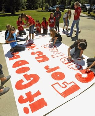 Kountze cheerleaders paint a Biblical 'run through' sign — Associated Press