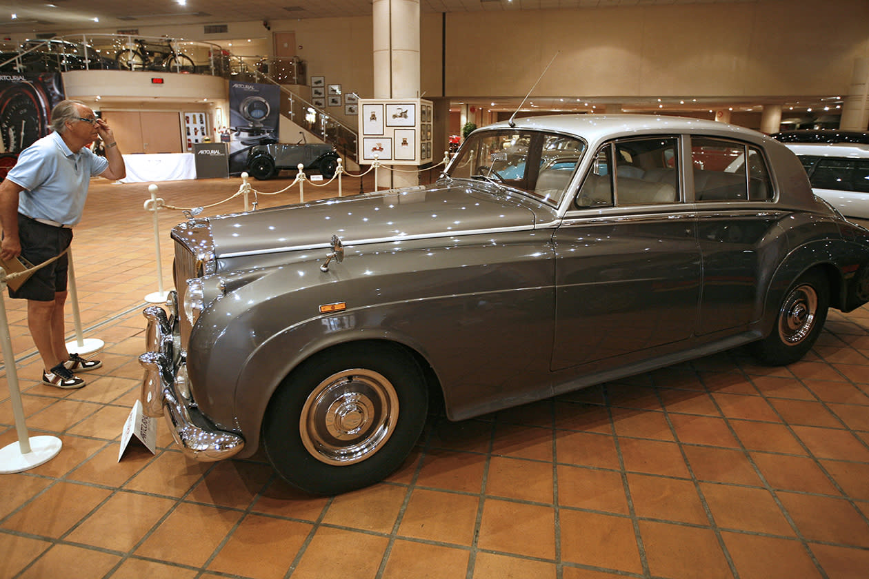 A worker cleans a Bentley S1 from the collection of Prince Albert II of Monaco at the Automobile Museum in Monaco.