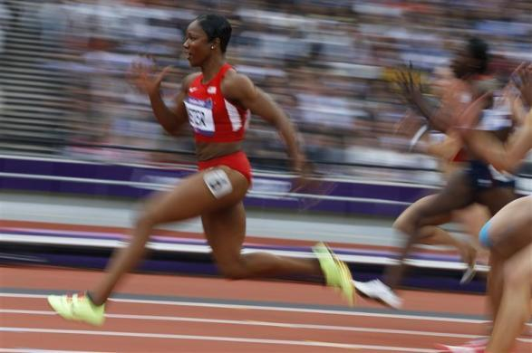 Carmelita Jeter of the U.S. breaks away from the field to win her women's100m heat 2 during the London 2012 Olympic Games at the Olympic Stadium August 3, 2012.
