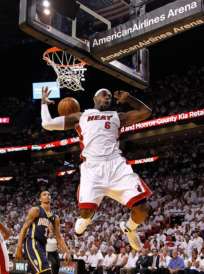 MIAMI, FL - MAY 22:  LeBron James #6 of the Miami Heat dunks during Game Five of the Eastern Conference Semifinals in the 2012 NBA Playoffs against the Indiana Pacers at AmericanAirlines Arena on May 22, 2012 in Miami, Florida. NOTE TO USER: User expressly acknowledges and agrees that, by downloading and/or using this Photograph, User is consenting to the terms and conditions of the Getty Images License Agreement.  (Photo by Mike Ehrmann/Getty Images)