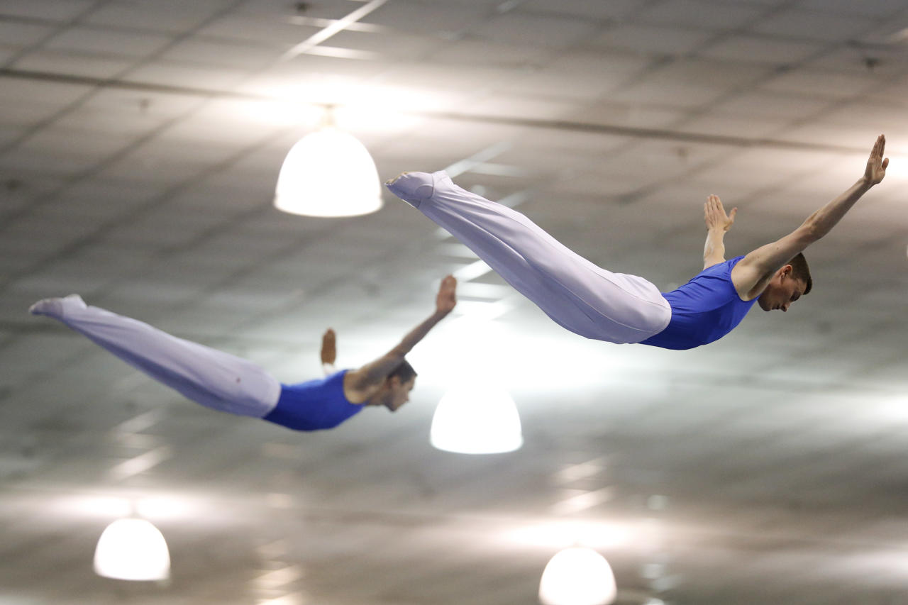 Steven Gluckstein, right, and Logan Dooley compete in the synchro trampoline event at the USA Gymnastics Championships in San Jose, Calif., Wednesday, June 27, 2012. The two placed second. (AP Photo/Jae C. Hong)