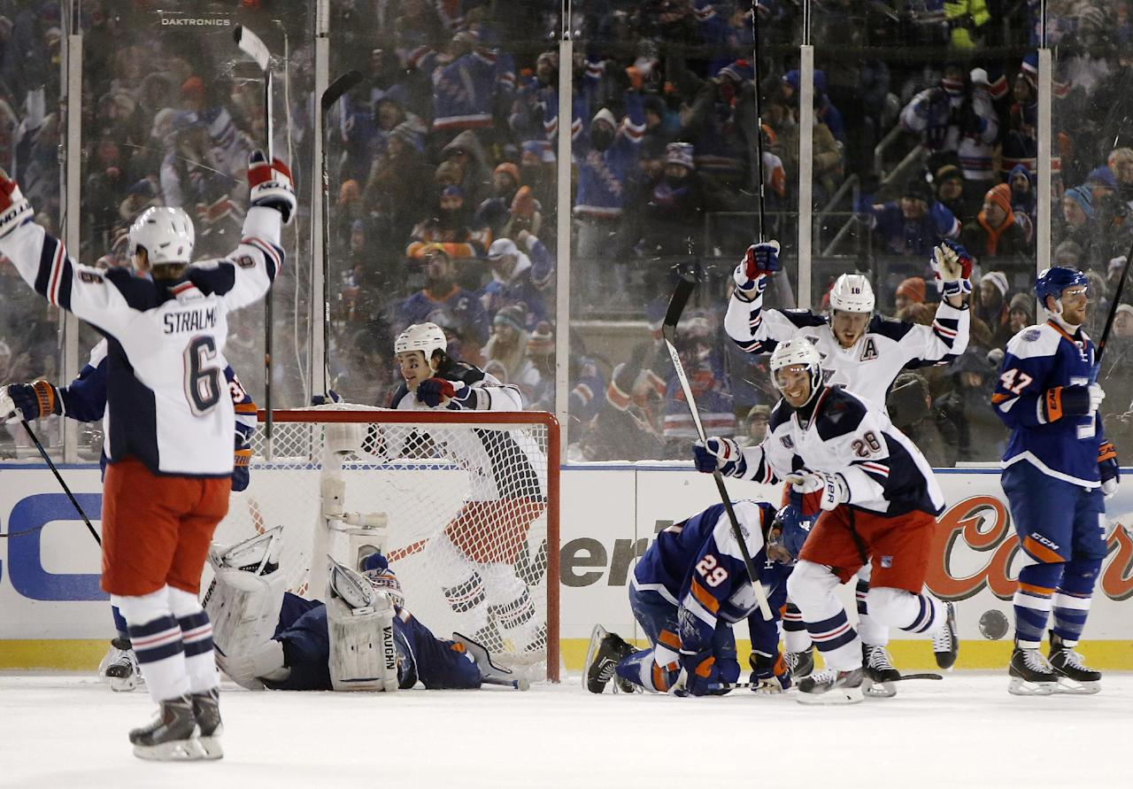 New York Rangers celebrate in the third period after left wing Daniel Carcillo, not seen, scored the go-ahead goal on New York Islanders goalie Evgeni Nabokov in an NHL hockey game at Yankee Stadium in New York, Wednesday, Jan. 29, 2014. The Rangers won 2-1. (AP Photo/Kathy Willens)