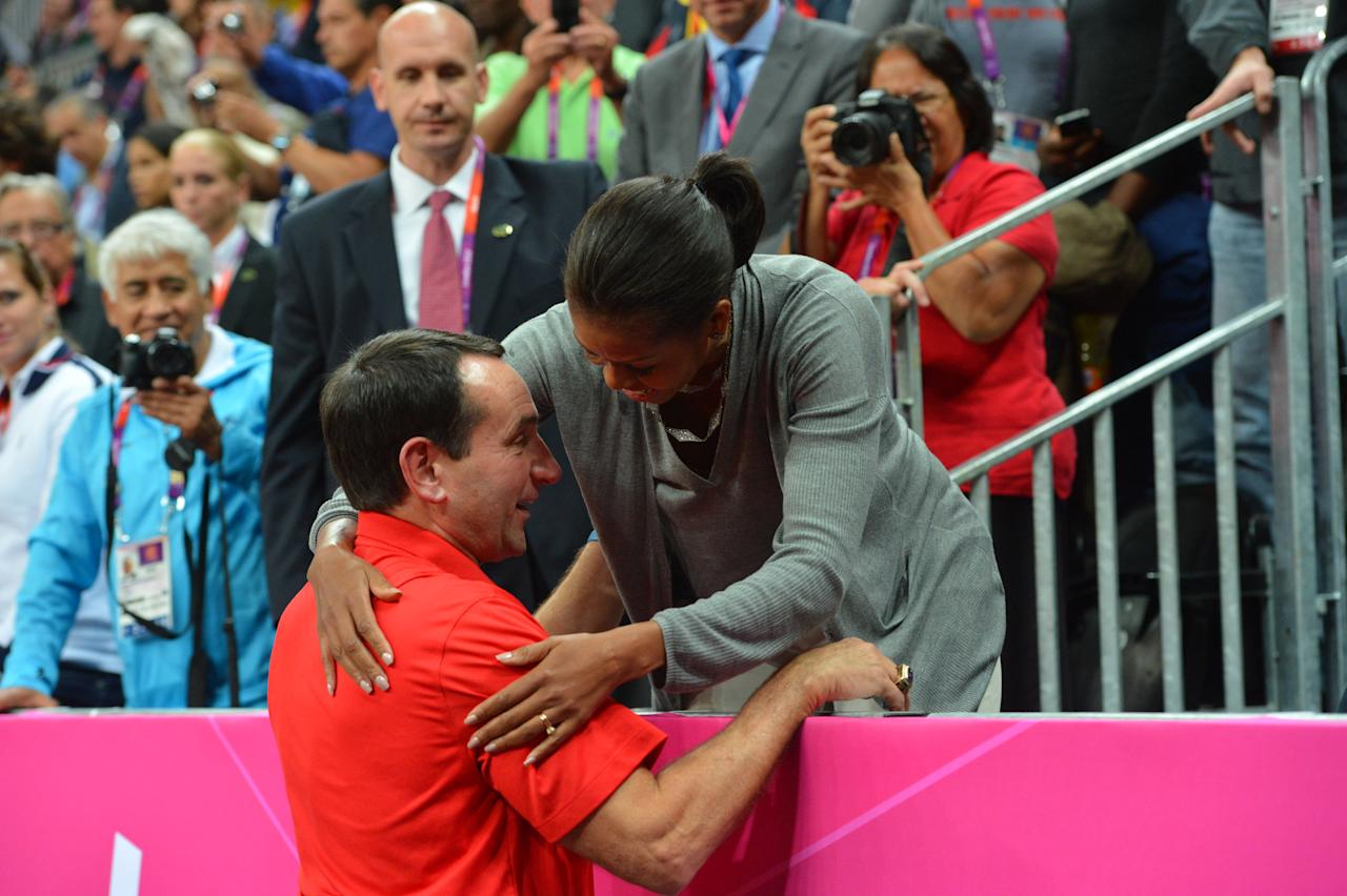 Head Coach Mike Krzyzewski of the USA Mens Senior National team talks to The First Lady Michelle Obama after defeating France 98-71 at the Olympic Park Basketball Arena during the London Olympic Games on July 29, 2012 in London, England. NOTE TO USER: User expressly acknowledges and agrees that, by downloading and/or using this Photograph, user is consenting to the terms and conditions of the Getty Images License Agreement. Mandatory Copyright Notice: Copyright 2012 NBAE (Photo by Jesse D. Garrabrant/NBAE via Getty Images)