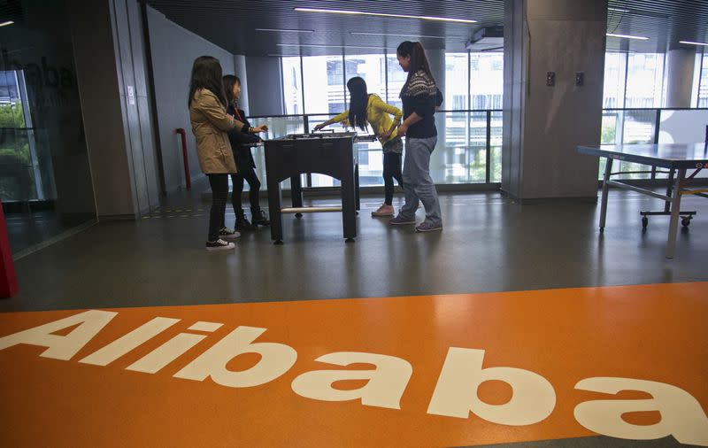 People play in a hall inside Alibaba's headquarters in Hangzhou