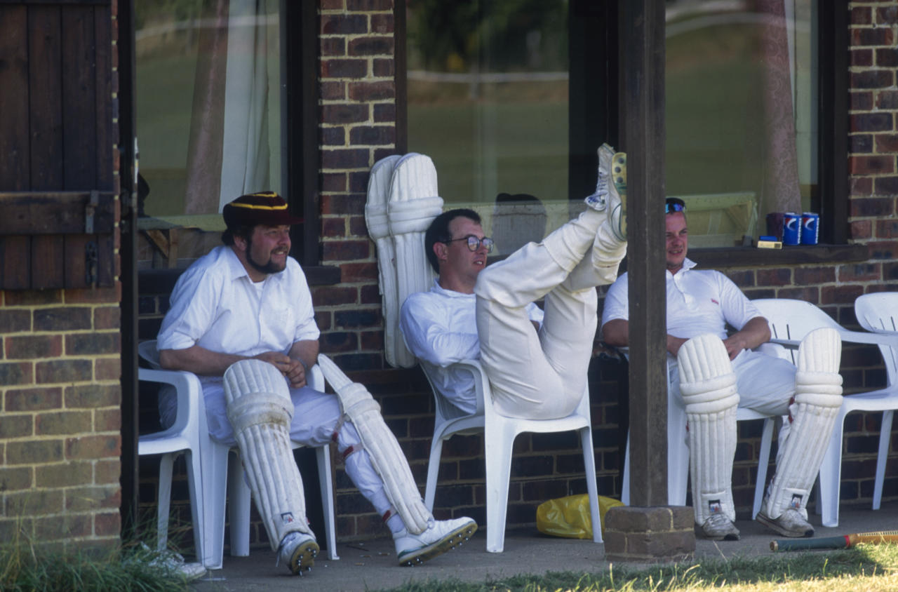BRAMLEY - 1995:  Players take a well earned break as they look on during the Village Cricket match between Bramley and Sunbury held in 1995 in Bramley, Surrey, England. (Photo by Adrian Murrell/Getty Images)