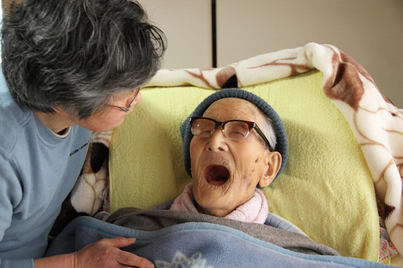 KYOTANGO, JAPAN - APRIL 19:  In this handout image provided by Kyotango City government, the world's oldest person Jiroemon Kimura speaks to granddaughter-in-law Eiko Kimura as he celebrates his 116th birthday at his home on April 19, 2013 in Kyotango, Kyoto, Japan. Kimura was born in 1897, has 7 children, 14 grandchildren, 25 great-grandchildren and 14 great-great-grandchildren.  (Photo by Kyotango City Government via Getty Images)