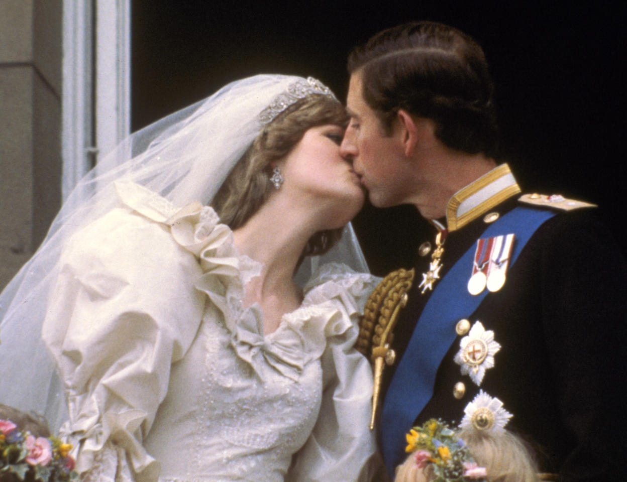 FILE - In this July 29, 1981 file photo, Britain's Prince Charles kisses his bride, the former Diana Spencer, on the balcony of Buckingham Palace in London, after their wedding, in this July 29, 1981 file photo. Princess Diana would have been 50 years old on Friday, July 1, 2011, perhaps the only certainty about the course of a life abruptly cut short in a 1997 car crash in Paris, with a new boyfriend, two months past her 36th birthday. (AP Photo/file)
