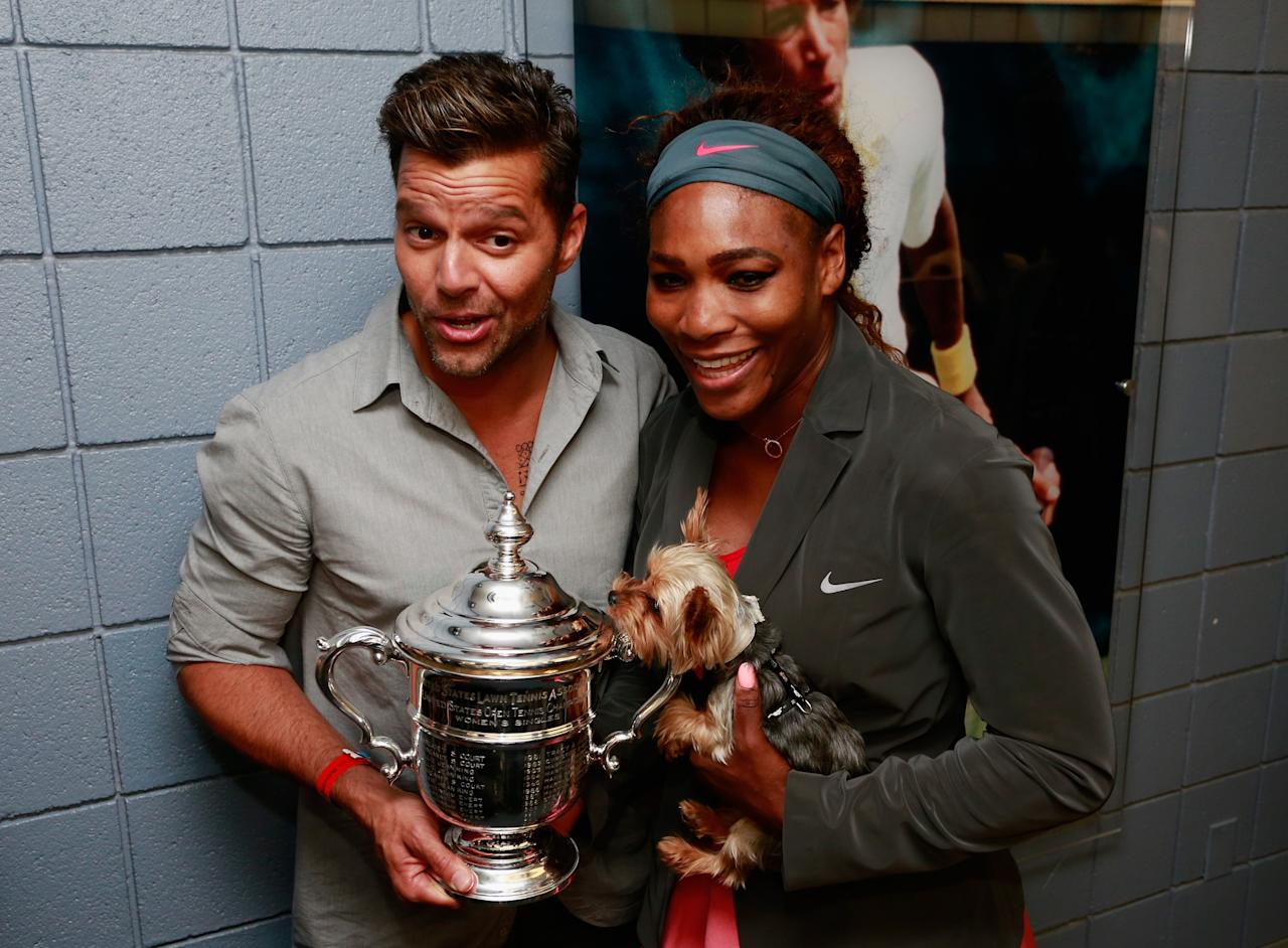 NEW YORK, NY - SEPTEMBER 08: Musician Ricky Martin holds the championship trophy alongside Serena Williams of the United States after her women's singles final victory on Day Fourteen of the 2013 US Open at the USTA Billie Jean King National Tennis Center on September 8, 2013 in New York City. (Photo by Chris Trotman/Getty Images for the USTA)