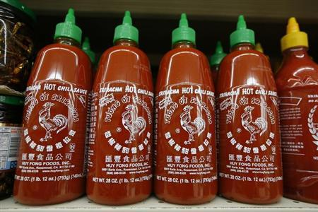 Bottles of Sriracha hot chili sauce, made by Huy Fong Foods, are seen on a supermarket shelf in San Gabriel