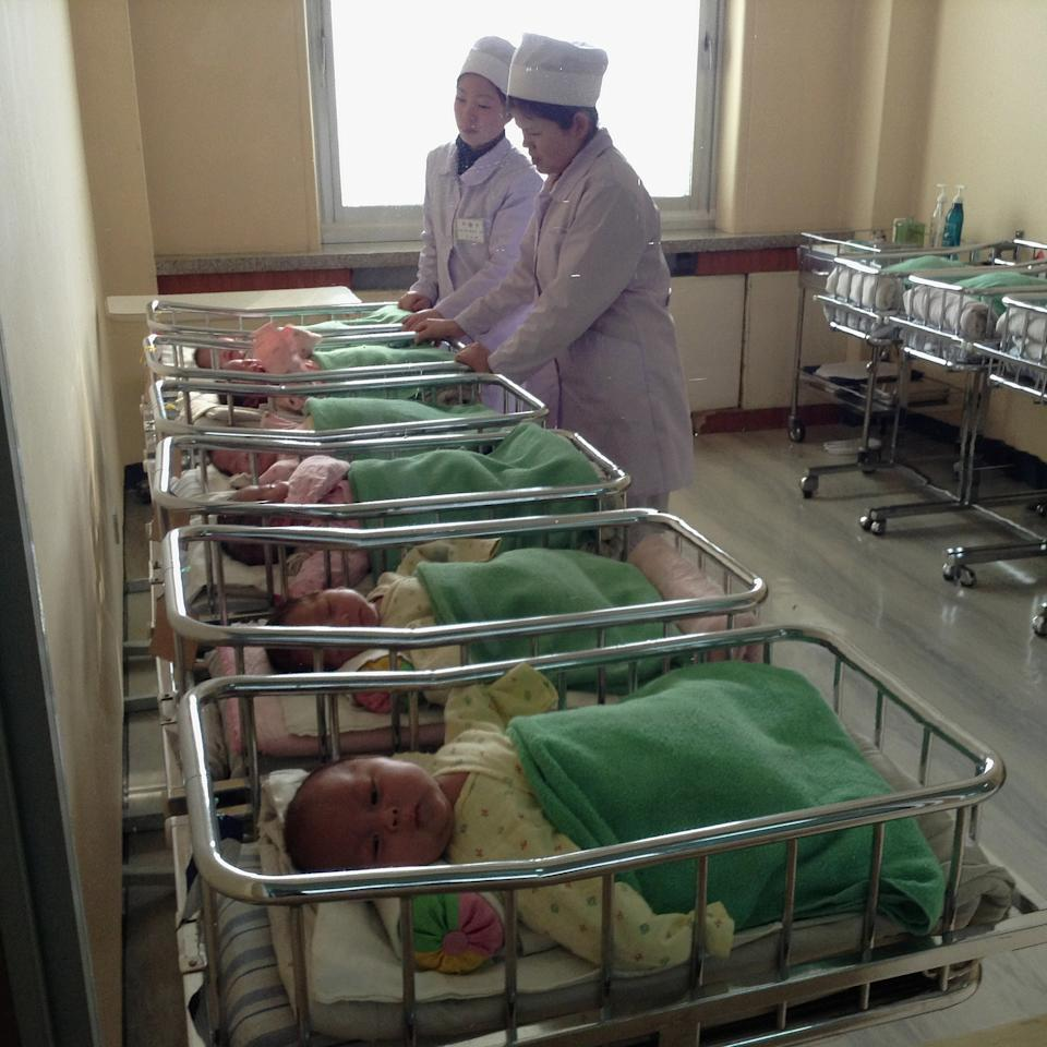 In this Feb. 20, 2013 photo taken with an iPhone and posted to Instagram on Feb. 21, 2013, North Korean nurses care for infants in cribs inside a maternity hospital, in Pyongyang, North Korea. On Jan. 18, 2013, foreigners were allowed for the first time to bring mobile phones into North Korea. And this week the local service provider, Koryolink, is allowing foreigners to access the Internet on a data capable 3G connection on mobile phones. (AP Photo/David Guttenfelder)