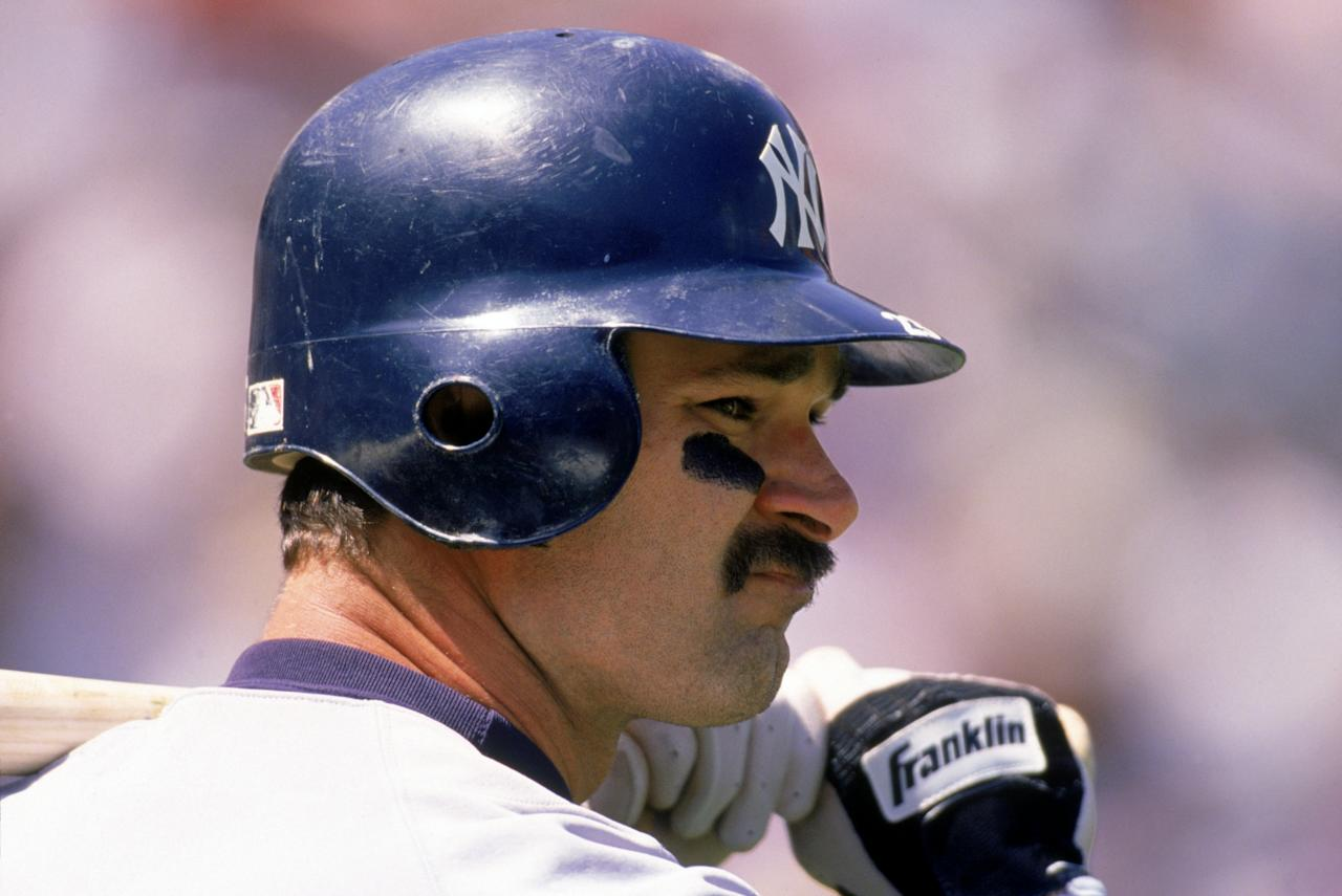 1993: Don Mattingly #23 of the New York Yankees looks on as he holds a bat over his shoulder during a 1993 season game. Don Mattingly played for the New York Yankees from 1982-1995. (Photo by Jeff Carlick/MLB Photos via Getty Images)