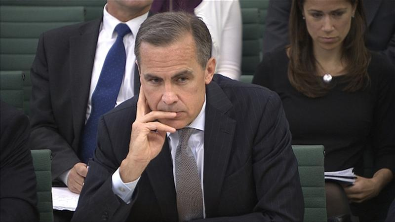 The Governor of the Bank of England Mark Carney listens to a question from the parliament's Treasury Committee in Westminster, London