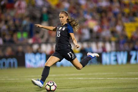 Sep 15, 2016; Columbus, OH, USA; USA forward Alex Morgan (13) shoots and scores her first goal of the match against Thailand at MAPFRE Stadium. The USA defeated Thailand 9-0. Mandatory Credit: Trevor Ruszkowski-USA TODAY Sports