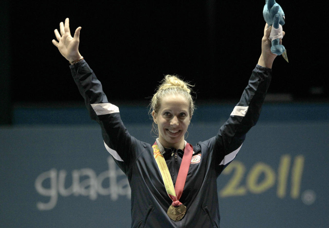 Gold medalist Mariel Zagunis, of the United States, waves to the crowd from the podium of the women's individual sabre of the fencing competition at the Pan American Games in Guadalajara, Mexico, Tuesday, Oct. 25, 2011. (AP Photo/Jorge Saenz)
