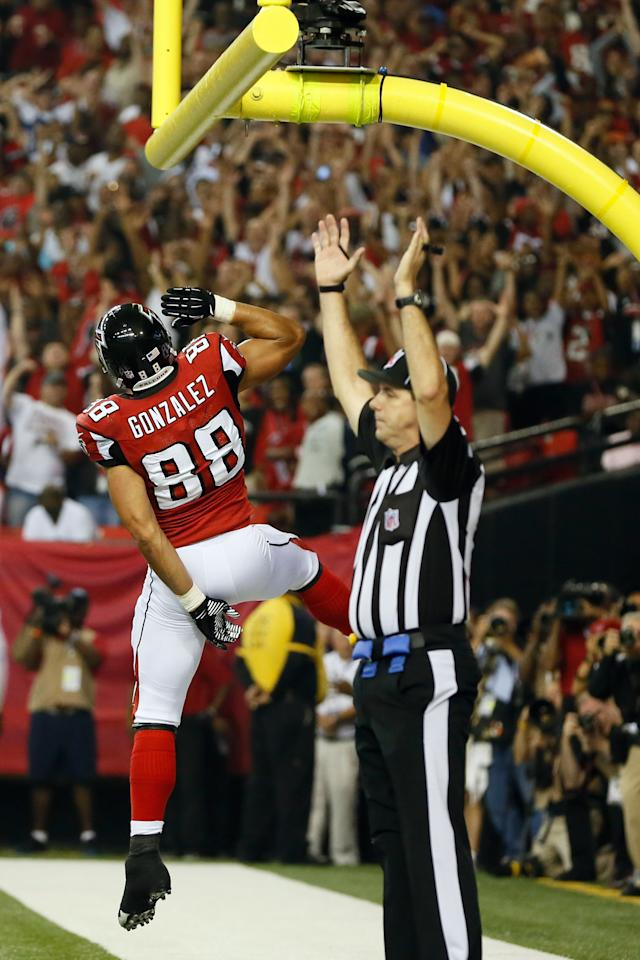 ATLANTA, GA - SEPTEMBER 17:  Tight end Tony Gonzalez #88 of the Atlanta Falcons celebrates after scoring a touchdown in the second quarter against the Denver Broncos during a game at the Georgia Dome on September 17, 2012 in Atlanta, Georgia.  (Photo by Kevin C. Cox/Getty Images)
