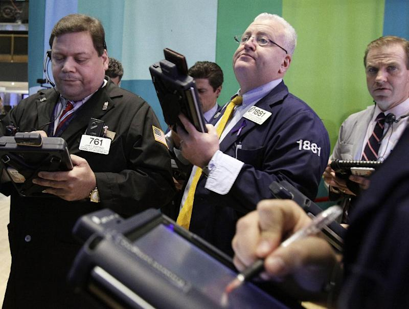 Traders work on the floor of the New York Stock Exchange Tuesday, Dec. 11, 2012. Stocks opened higher Tuesday ahead of a meeting of the Federal Reserve and possible additional steps to bolster the U.S. economy.  (AP Photo/Richard Drew)