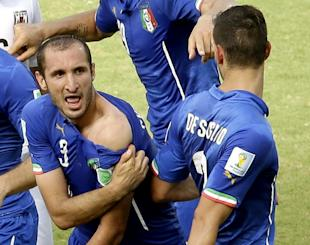 Italy's Giorgio Chiellini shows apparent teeth marks on his shoulder after the incident with Luis Suarez. (AP)