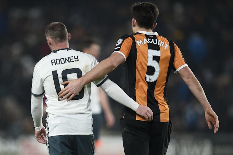Manchester United's Wayne Rooney (L) greets Hull City's defender Harry Maguire after their EFL Cup semi-final match in Kingston upon Hull, north east England on January 26, 2017