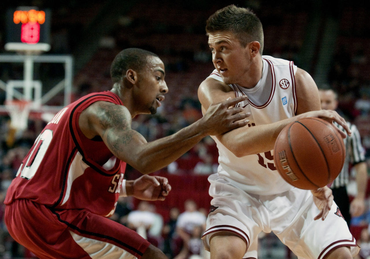 Arkansas guard Rotnei Clark, right, looks to pass around Southeast Missouri State guard Anthony Allison, left, during the first half of an NCAA college basketball game in Fayetteville, Ark., Wednesday, Nov. 24, 2010.