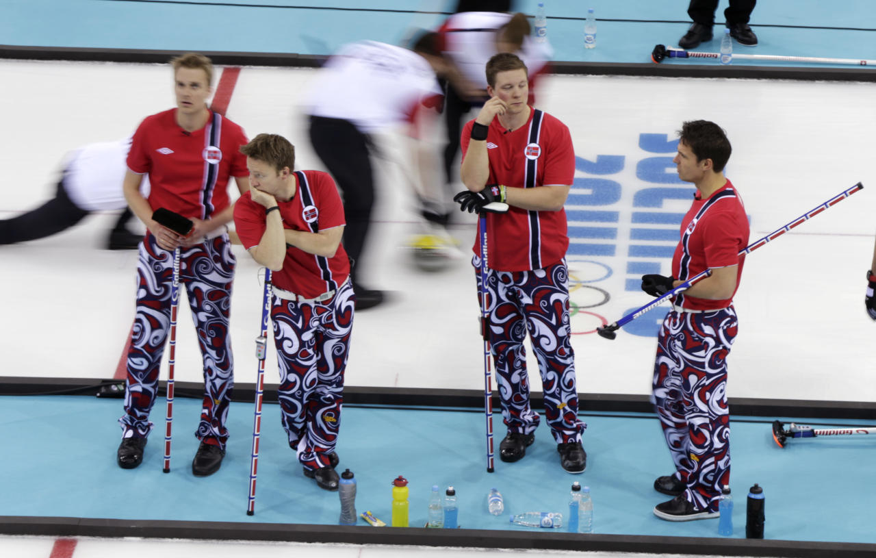 Norway player, from left, Haavard Vad Petersson, Torger Nergaard, Christoffer Svae, and skip Thomas Ulsrud wait for their turn to throw during men's curling competition against Denmark at the 2014 Winter Olympics, Monday, Feb. 17, 2014, in Sochi, Russia. (AP Photo/Robert F. Bukaty)