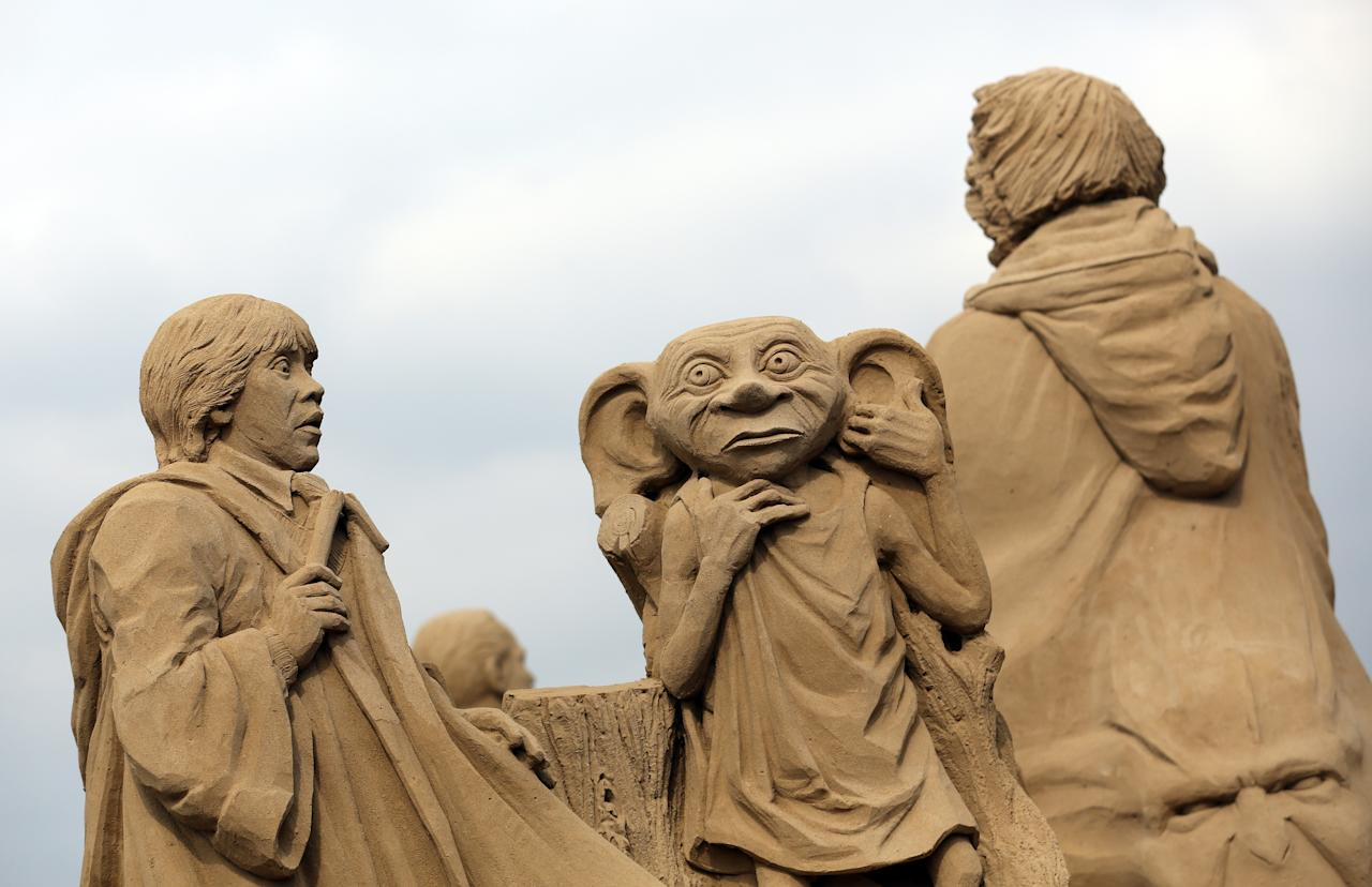 WESTON-SUPER-MARE, ENGLAND - MARCH 26:  Detail of a sand sculpture of Harry Potter is seen as pieces are prepared as part of this year's Hollywood themed annual Weston-super-Mare Sand Sculpture festival on March 26, 2013 in Weston-Super-Mare, England. Due to open on Good Friday, currently twenty award winning sand sculptors from across the globe are working to create sand sculptures including Harry Potter, Marilyn Monroe and characters from the Star Wars films as part of the town's very own movie themed festival on the beach.  (Photo by Matt Cardy/Getty Images)