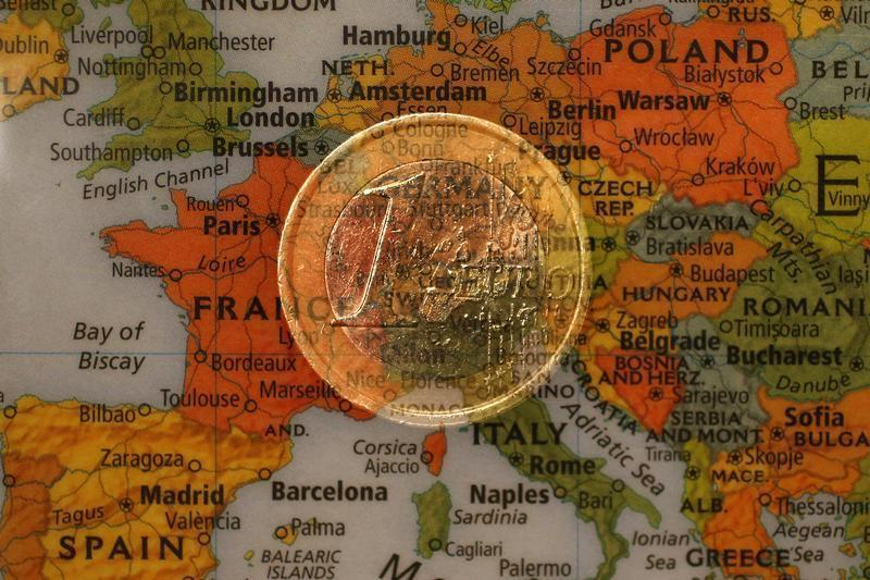 A picture illustration taken with the multiple exposure function of the camera shows a one Euro coin and a map of Europe